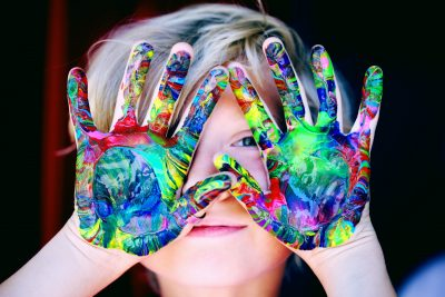 Image of Child with paint on hands